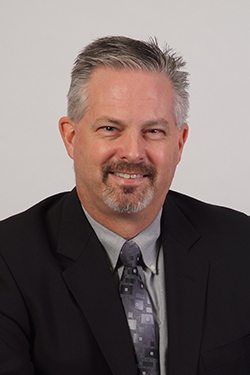 Headshot of John Moll, Chief Executive Officer of Gemini Group, Inc.
