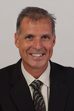 Headshot of T L Bushey, Chief Financial Officer of Gemini Group, Inc.