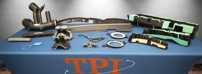 An assortment of two-shot injection molded and insert molded parts manufactured by Thumb Plastics.