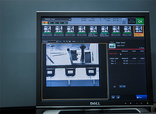A screenshot of a dimensional video testing system as it analyzes a plastic injection molded component..