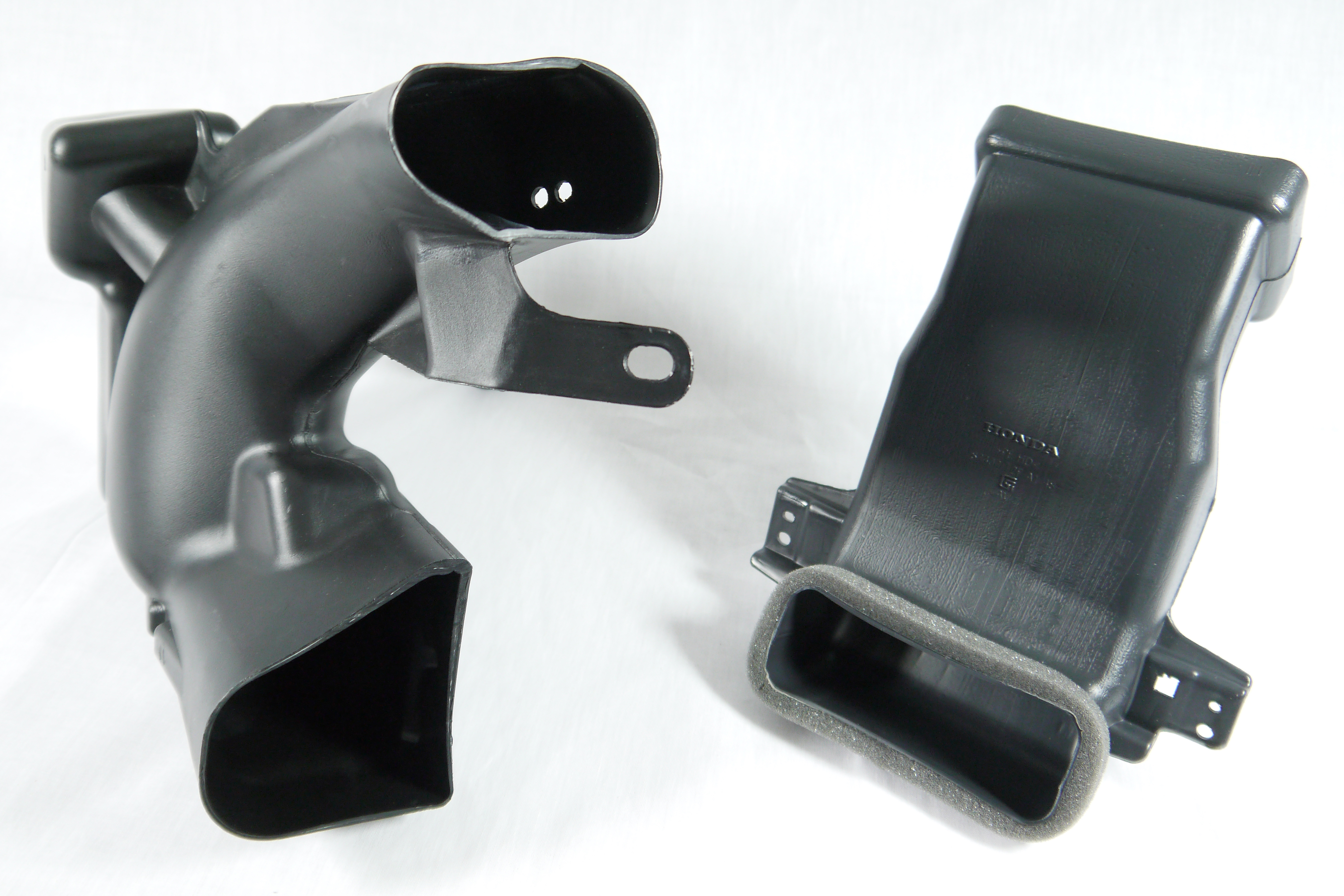 Two components of a blow molded HVAC duct assembly.