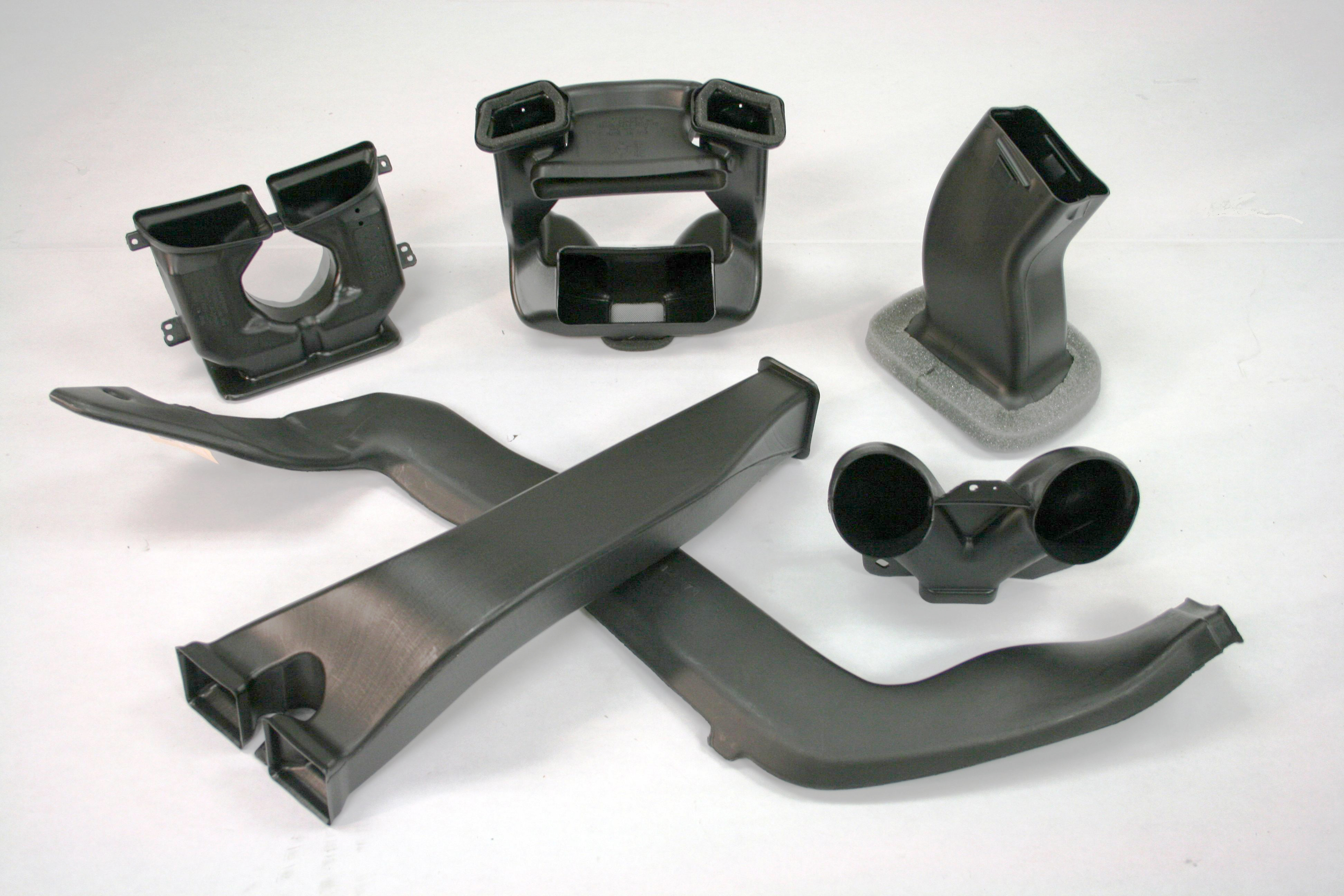 A variety of blow molded HVAC duct components.