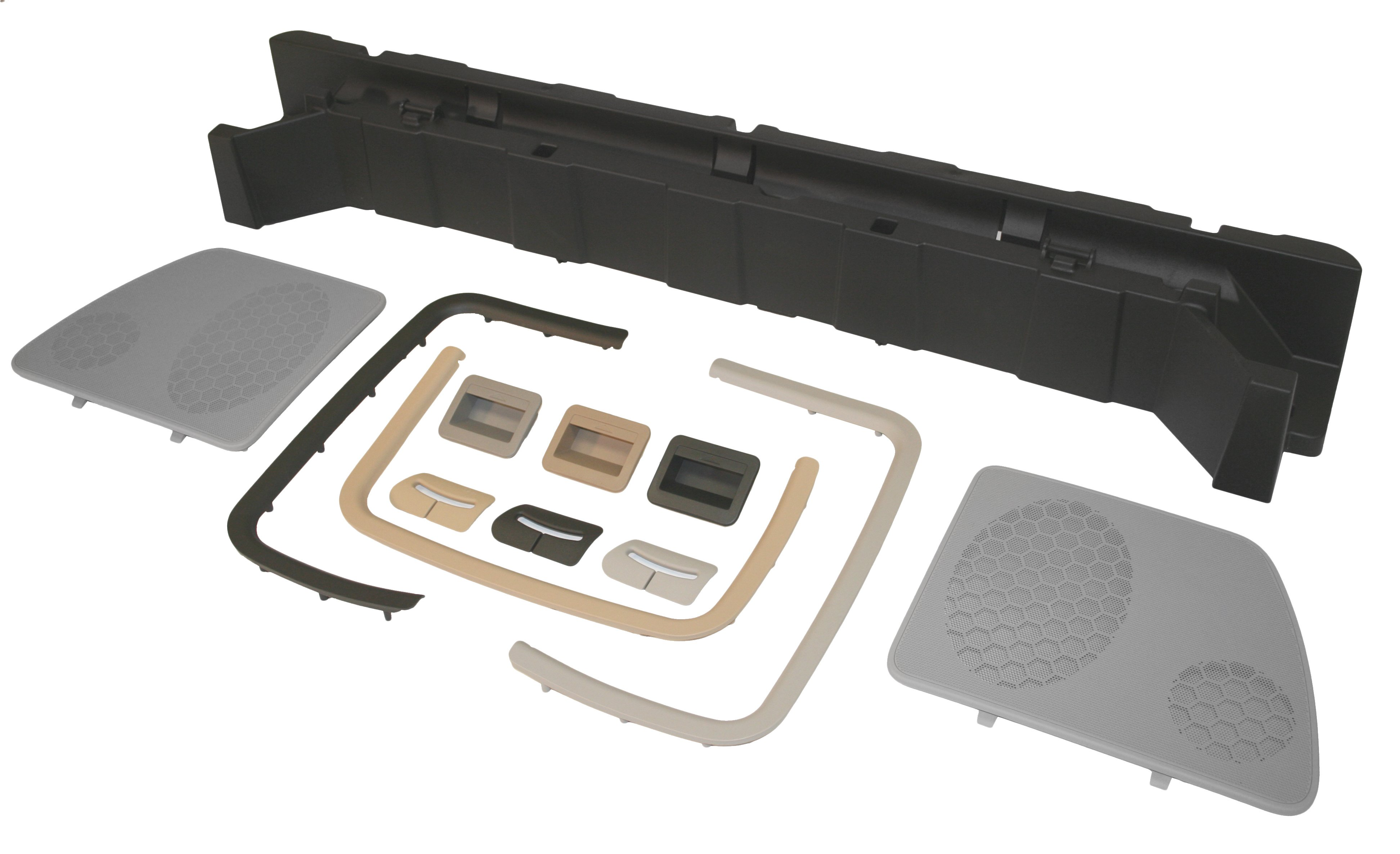 An assortment of injection molded interior trim components.