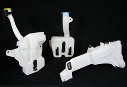 An assortment of plastic blow molded fluid reservoirs.