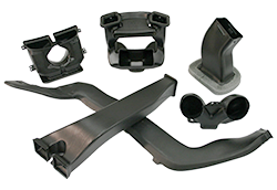 An assortment of blow molded plastic HVAC ducts and components.