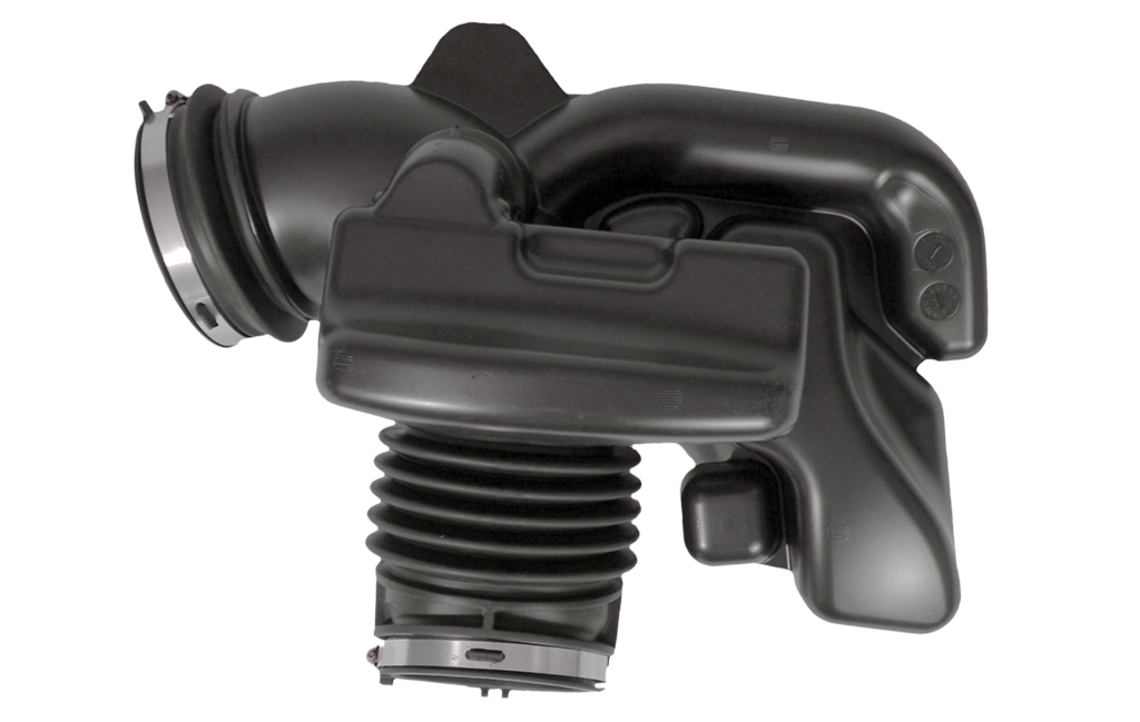 A blow-molded air induction unit, part of the air intake system of an automobile.