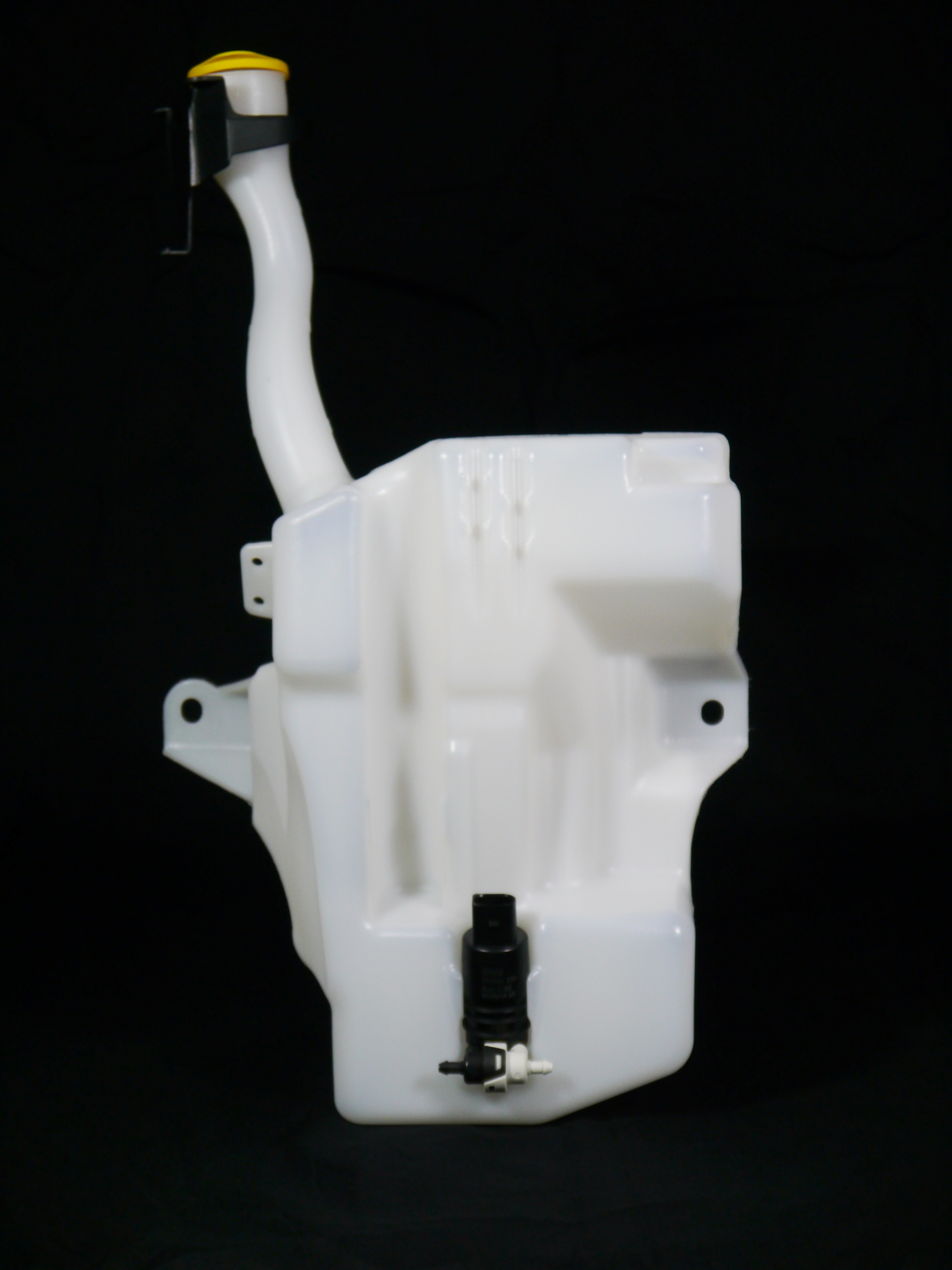 The front of a blow molded washer fluid tank with a fluid pump and censor.