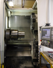 A CNC machining cell for high-precision metal parts.