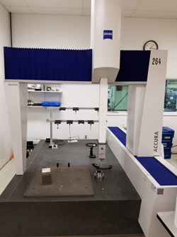 A full view of a CMM inspection machine made by Accura.